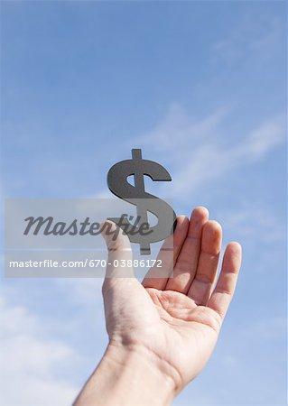 Hand holding dollar sign