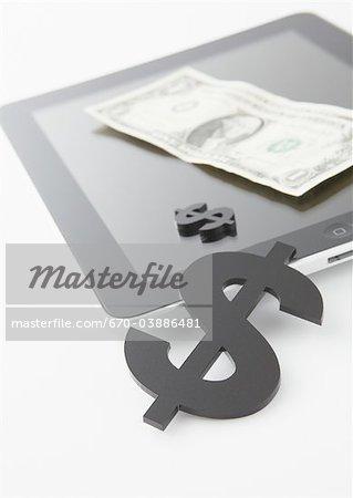 Tablet PC et signes dollar bill