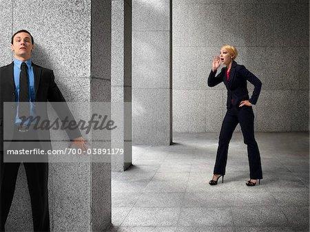 Businessman Hiding from Businesswoman