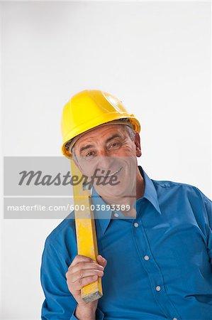 Man Holding Carpenter's Level