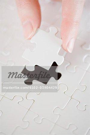 Ein Puzzle mit einem fehlenden Stück.
