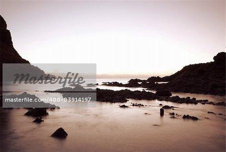 Early Morning Sunrise over Coastline Rocks