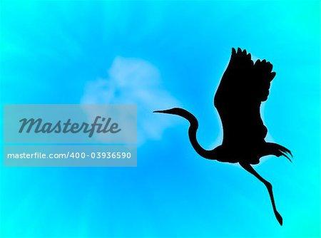 Heron silhouette flying in a blue sky