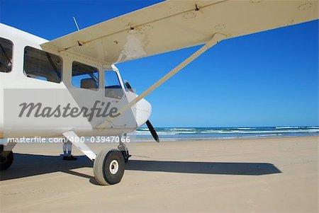 A light aircraft on a beach.