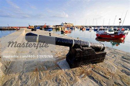 lyme regis dorset england uk canon harbour wall