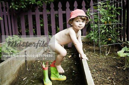 Toddler Playing in Garden