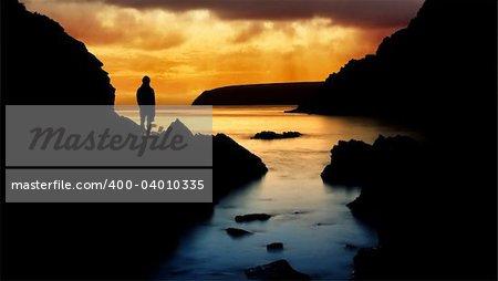 Man looking at beautiful Sunset