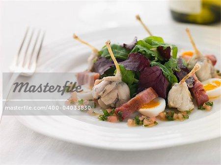 Salad of Frog Legs Lardons and Quail Eggs