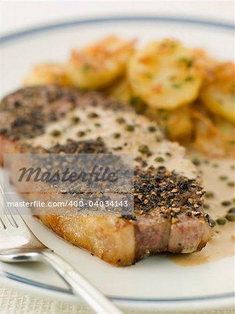 Steak au Poirve' with Saut Potatoes