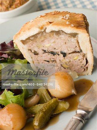 Pork Black Truffle and Pistachio Pie with Glazed Button Onions a