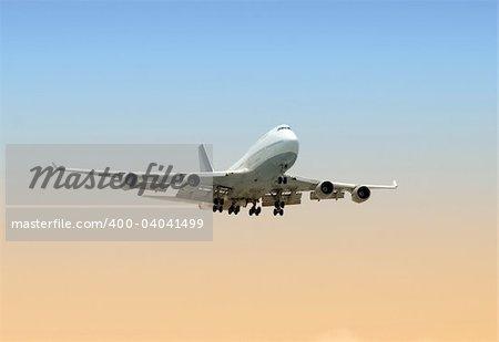 Widebody passenger jet airplane before landing