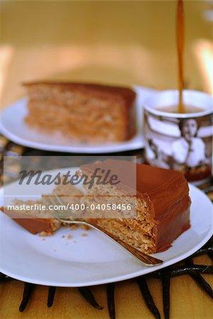 chocolate cake and coffee being poured into mug