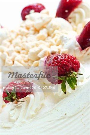 Strawberry meringue cake close up on white background