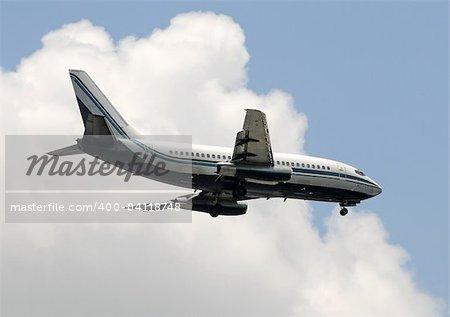 Old passenger jet passing overhead