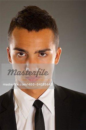 Great Looking Businessman Portrait shot in studio isolated on dark background