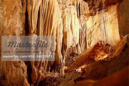 cave stalactites underground cavern magic light in Pyrenees Spain