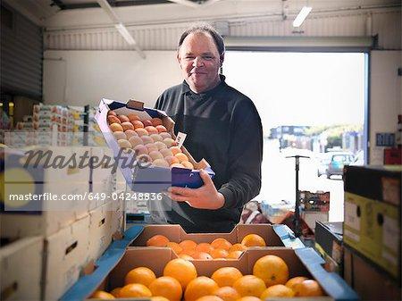 Épicier aux abricots et oranges