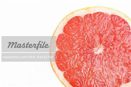 Fresh Grapefruit on white background (isolated, close-up)