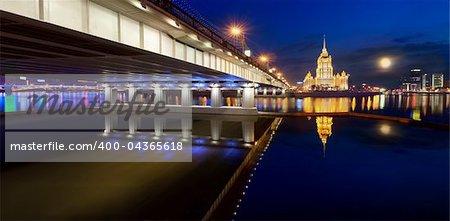 Night Moscow. Moscow River. A kind from Krasnopresnenskaya quay on hotel Ukraine and on the New Arbat bridge. Panorama.