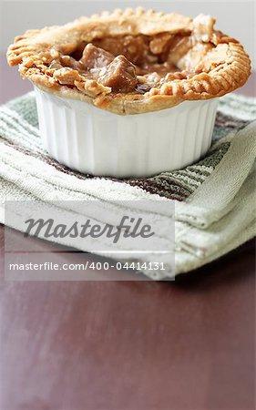 Vertical image of beef pot pie with extra copyspace