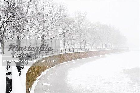 Kronverk embankment and Kamennostrovski Prospekt at snowfall in Saint Petersburg, Russia.