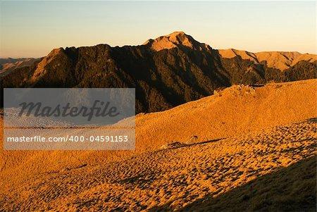 The sunrise golden beautiful high mountain landscape.