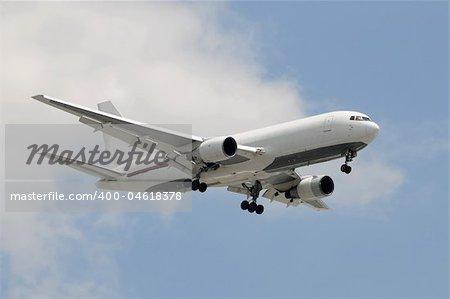 Wide body cargo jet airplane in flight