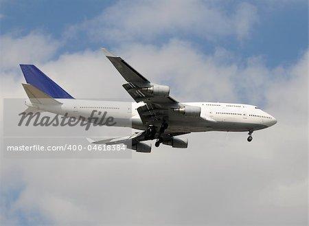 Modern wide body passenger jet before landing