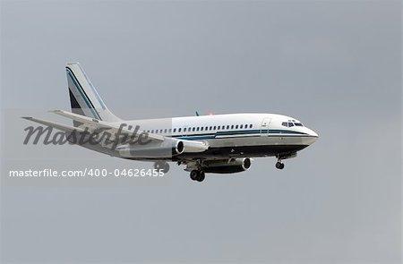 Retro passenger jet airplane minutes before landing