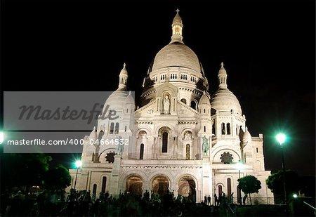 Beautiful church Sacre Coeur in Paris, France shot at night