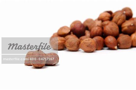 a pile of peeled hazelnuts isolated on a white background