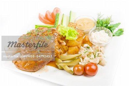 Tasty pork brisket dish with vegetables on a white background