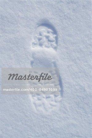 Human boot footprint in newly fallen snow