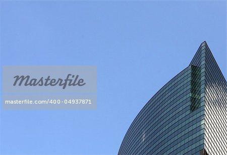 Modern skyscrapers against a bright blue sky