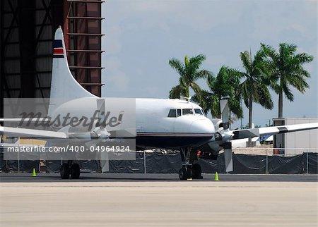 Classic transport airplane at hangar