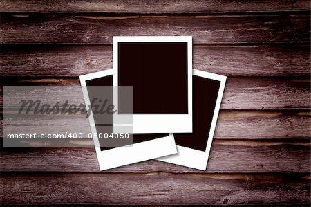 Historical polaroid photo concept Wooden background photo frame.