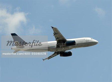 Modern passenger jetliner climbing after takeoff