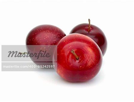 Three fresh ripe plums