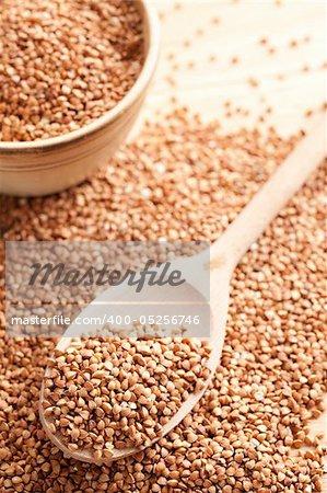 photo shot of buckwheat in wooden spoon