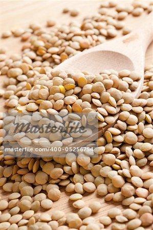 photo shot of  lentil on wooden spoon