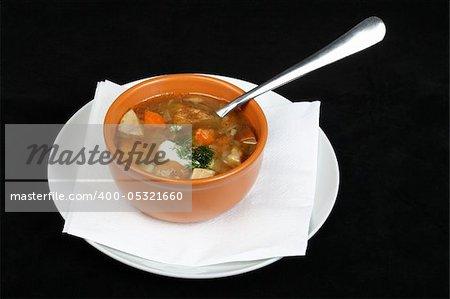 Mushroom soup at a black background