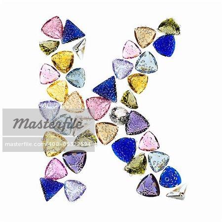Gemstones alphabet, letter K. Isolated on white background.