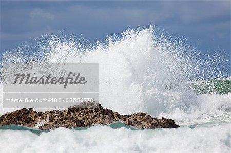 Wave crashing against rocks