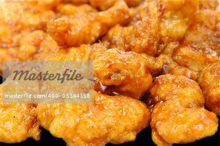 Delicious honey glazed orange chicken pieces macro