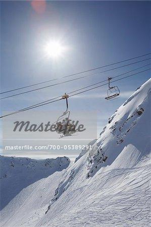 Skiers on Ski Lift, Whistler Mountain, Whistler, British Columbia, Canada