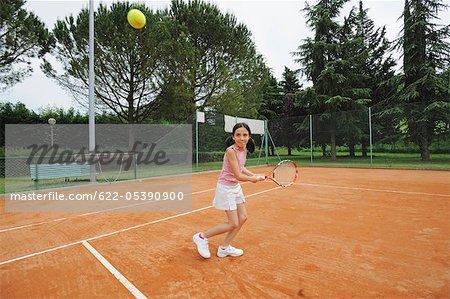 Young Girl Running For Backhand Shot