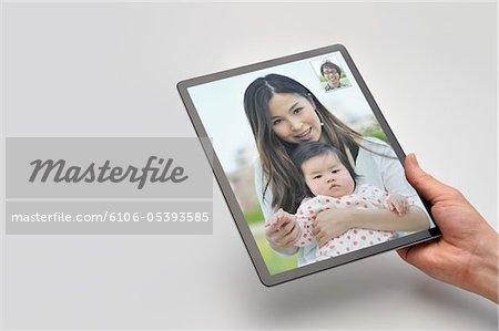 Motion picture de Tablet PC dans la main, appelez