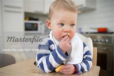 Portrait of Baby Girl Eating, London, England
