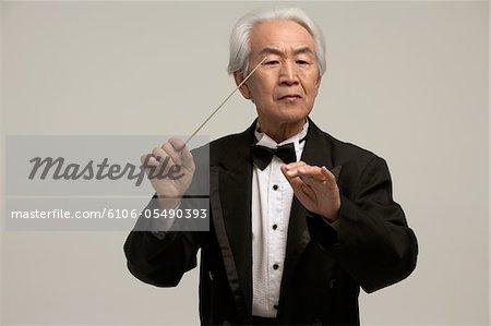 Bâton de chef d'orchestre chinois holding