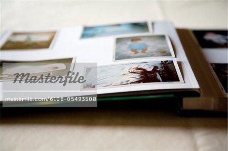 photos of a baby in a photo album